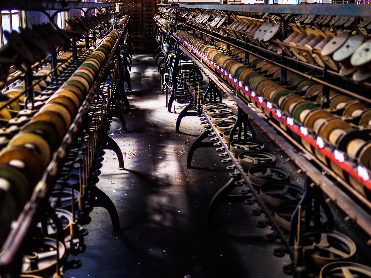 photo of rows of equiptment at silk mill